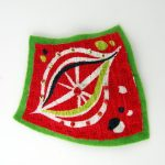 brooch made from red 50s fabric