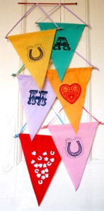 Pennants / flags from Printed Wonders hanging on a door